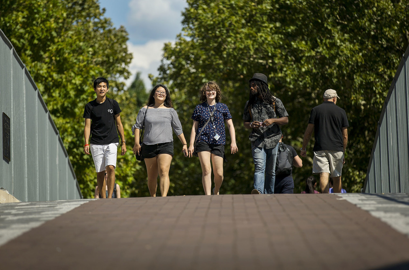 students walking over the 38th street bridge