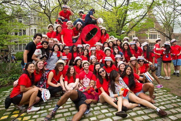 Students celebrating Hey Day in front of the campus LOVE statue