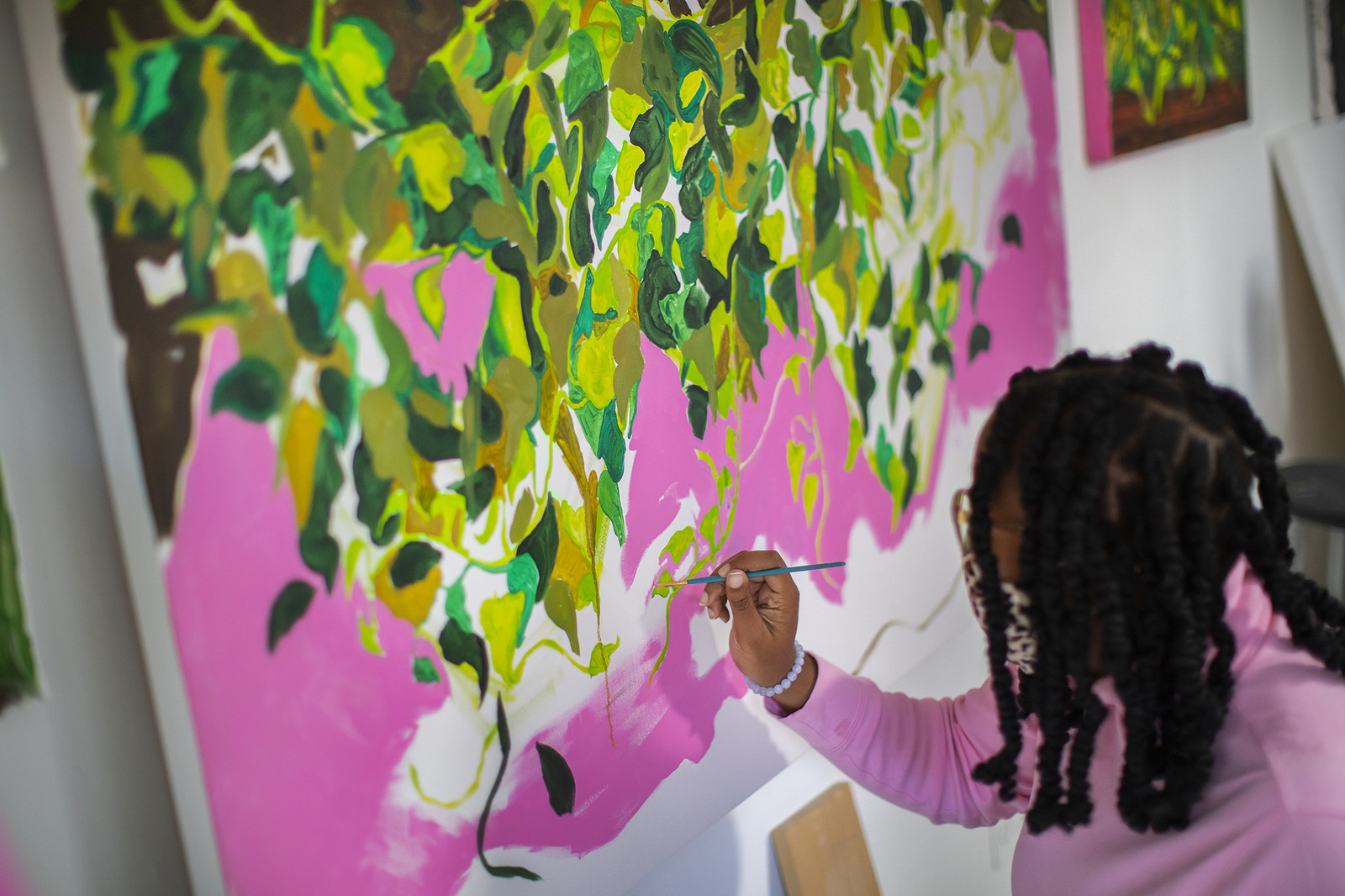 graduate student painting a mural